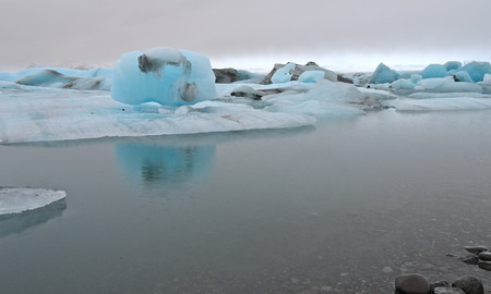 Blue icebergs floating in the jokulsarlon lagoon in Iceland in the winter, Iceland photo