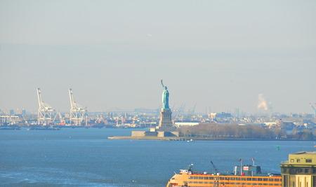 The Statue of Liberty at sunrise, New York City, USA photo