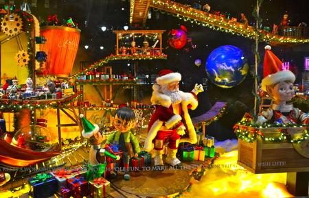 windows: NEW YORK - DECEMBER 12, 2014: Spectators view holiday window display at MACY