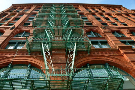 tenement: Old building with fire escape, New York City, USA.