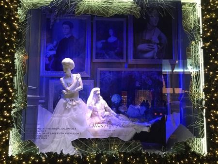 fifth: Spectators view holiday window display at Saks Fifth Avenue in NYC on December 1, 2015.