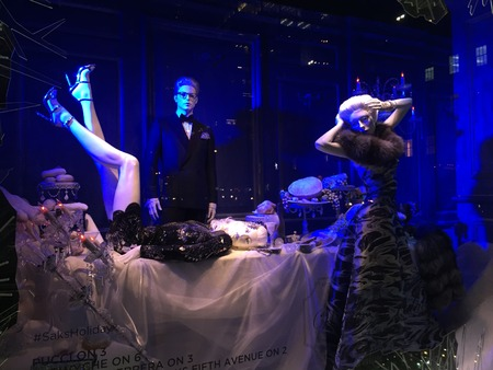 holiday display: Spectators view holiday window display at Saks Fifth Avenue in NYC on December 1, 2015.