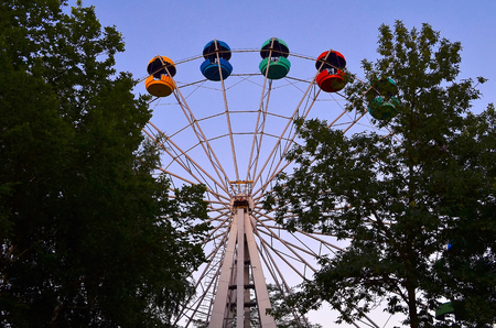 full suspended: Ferris wheel. When you ascend to the top, the entire city of Kramatorsk in full. An amusement-park or fairground ride consisting of a giant vertical revolving wheel with passenger cars suspended on its outer edge. Stock Photo
