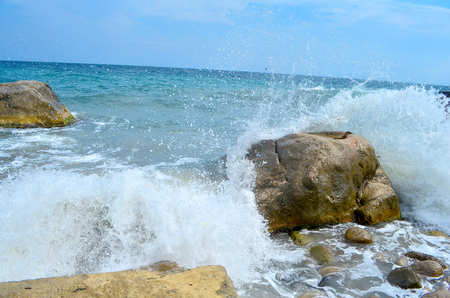 brings: Black Sea. Small storm in the Black Sea in Crimea, an exciting spectacle. Waves with human growth. The sea in bad weather does seem black. The sound of waves and wind are delighted and at the same time brings the fear of the people that we have no control Stock Photo