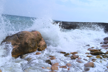 exciting: Black Sea. Small storm in the Black Sea in Crimea, an exciting spectacle. Waves with human growth. The sea in bad weather does seem black. The sound of waves and wind are delighted and at the same time brings the fear of the people that we have no control Stock Photo
