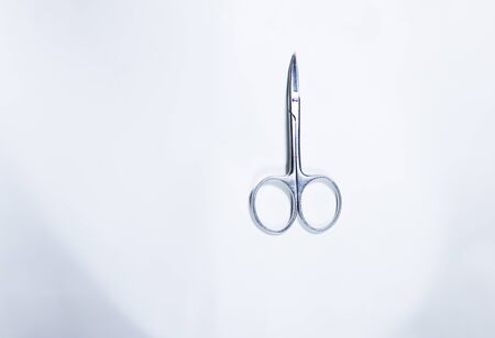 The nail scissors on white