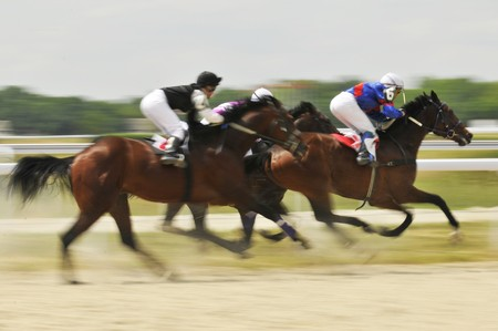 Slow shutter, racing jockeys and horses