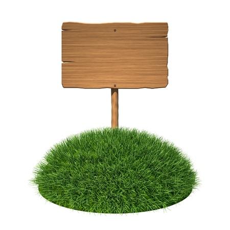 Wooden signboard on grass land photo