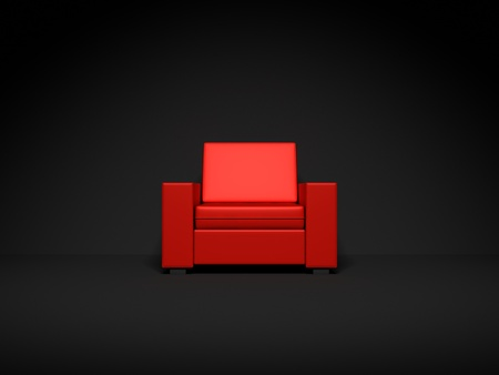 red couch: Red chair in dark room