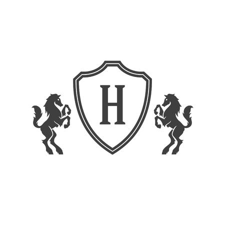 Heraldic horses and monogram on shield Isolated on white background