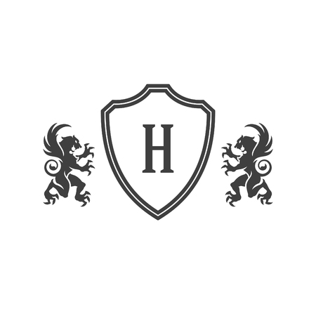 Heraldic lions and monogram on shield Isolated on white background