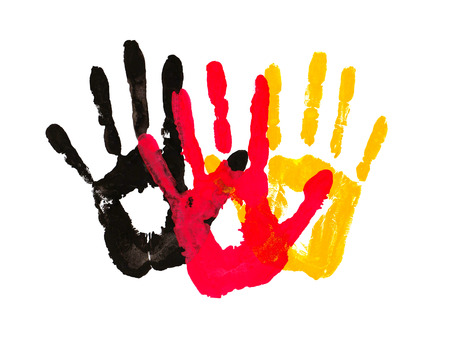 Yellow black red ink imprint. Handprints in the form of a flag of Germany, image of unity, freedom, independence.