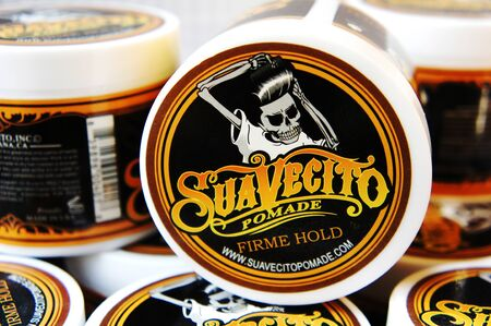 trendy barbershop styling. gel for male styling - SuaVecito. SuaVecito pomade strong firme hold. 版權商用圖片 - 137008960