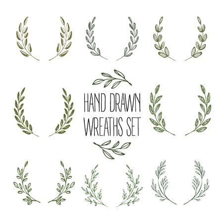 Set of hands drawn decorative wreaths. Vector illustration