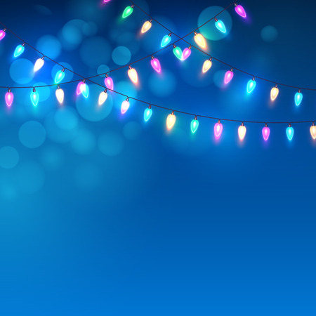 Blue Christmas background with lights.