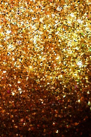 Golden glitter texture on black background