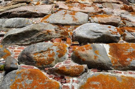 the tethe texture of the stone masonry fortresses in the North of Russiaxture of the stone masonry fortresses in the North of Russia Stock Photo