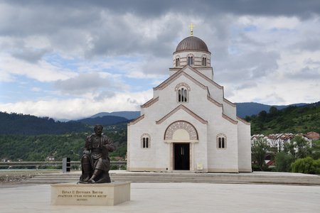 Bosnia and Herzegovina, Visegrad, Andrichgrad - May 31, 2014: Monument to Petar II Petrovich Njegosh is installed on the square in front of the church of St. Prince Lazarus