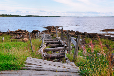 Destroyed the old wooden stairs to the beach. The white sea, Kem, Karelia, Russia Stock Photo