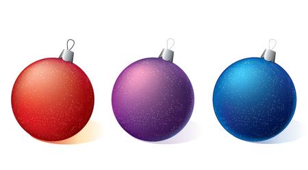 白い背景の上の 3 つのクリスマス飾り