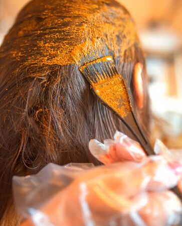 Process of coloring hair with natural henna. Zdjęcie Seryjne
