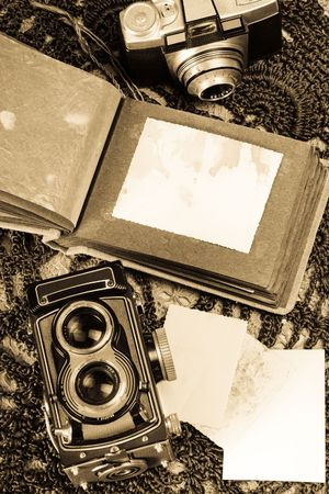 old camera: Old photo album and two film cameras. Stock Photo