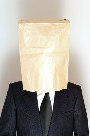 Businessman with paper bag over his head