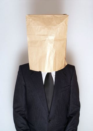 head down: Businessman with paper bag over his head