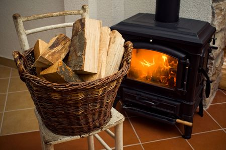 Logs in front of a stove Stock Photo - 6322166