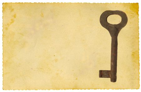 Old key on vintage paper. Isolated on white. photo