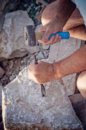 chisel: Stonemason working