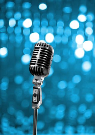 Retro microphone on blue stage Stock Photo