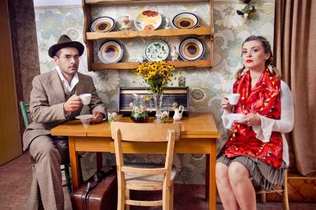 Retro couple drinking coffee or tea photo