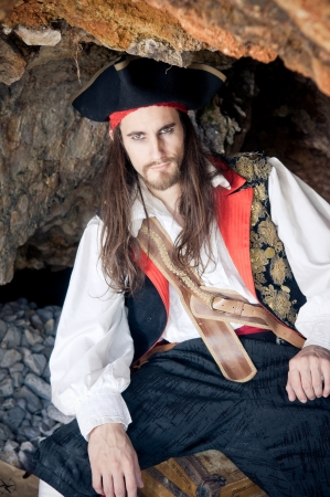 chest hair: Pirate siting on treasure trunk