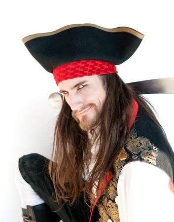 sombrero pirata: Poderoso pirata con espada  Foto de archivo