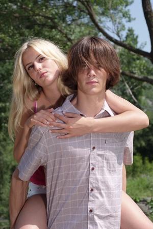 Teenage couple in nature photo