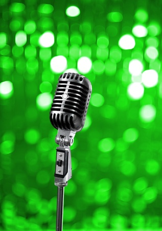 Retro microphone on green stage Stock Photo