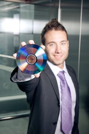 Businessman showing CD or DVD photo