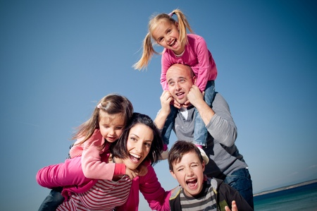 Happy family smiling and having fun outdoors  photo