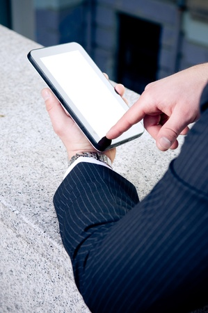 Businessman holding touchscreen tablet Stock Photo - 9428816