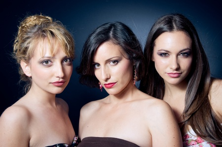 Three beautiful and confident young woman photo