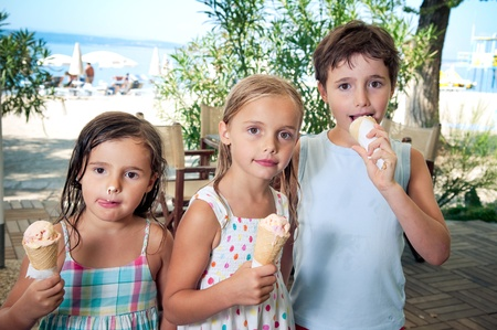 Three kids eating ice cream photo
