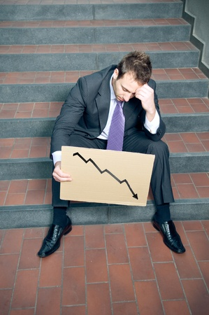 negativity: Desperate Businessman Showing Negative Graph