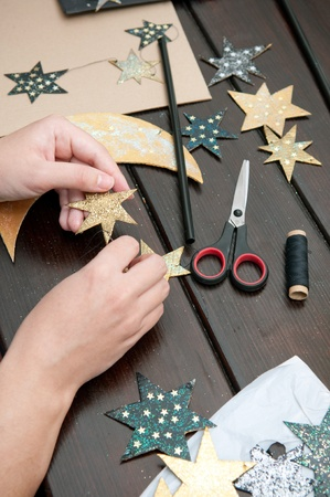 Woman Hands Crafting Cardboard Mobile Stock Photo