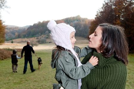 Family having a walk outdoors in autumn  photo