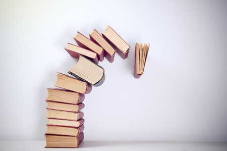Falling books on simple background Stock Photo
