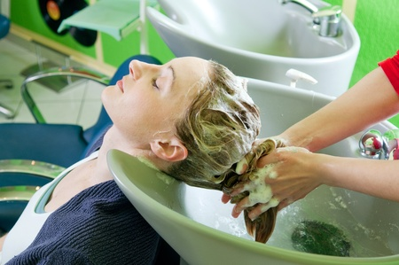 beauty salon face: Woman washing hair in hair salon