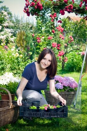 Youn woman working in her garden