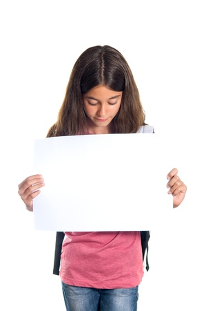one sheet: Schoolgirl with backpack holding a white sheet of paper  Stock Photo