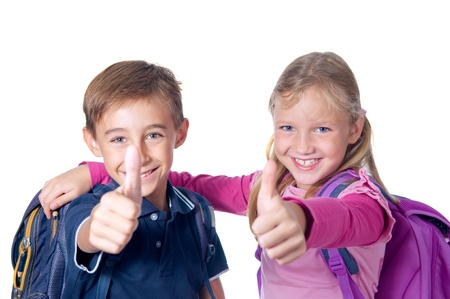 School children with backpacks showing thumbs up. Isolated on white.  photo
